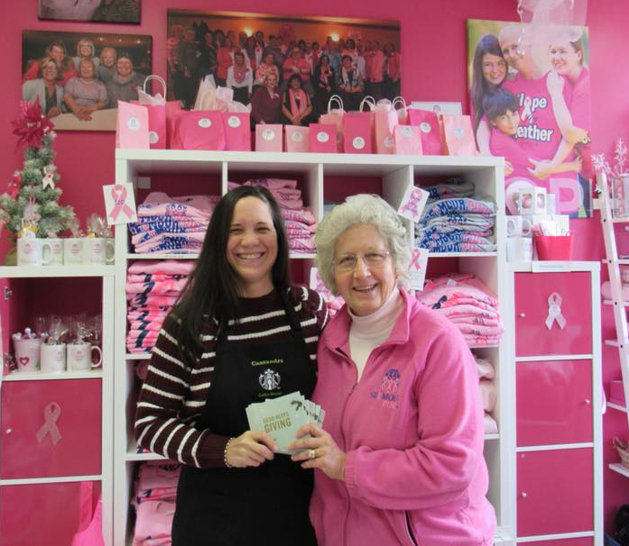 Cassandra Dessureau-O'Hara, the manager of Starbucks of Seymour, gives #ProjectGiveGood gift cards to Mary Deming from Seymour Pink